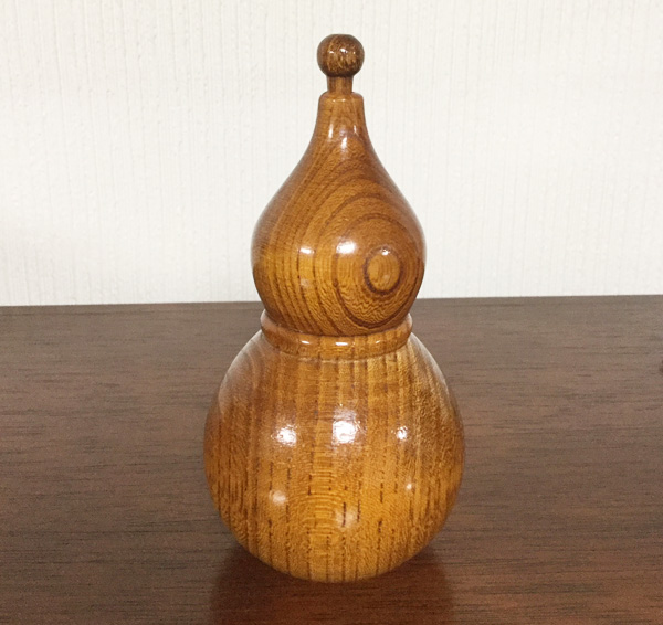 Contenitore in legno a forma di zucca lagenaria